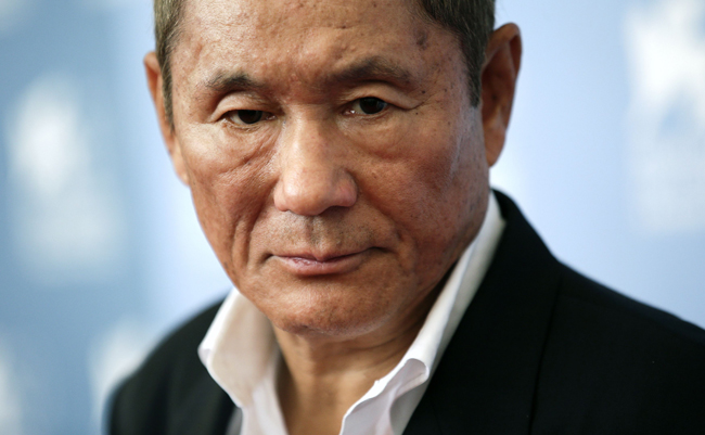 """Japanese director Kitano poses during the photocall of the movie """"Outrage Beyond"""" at the 69th Venice Film Festival"""